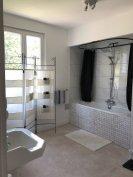 Main bathroom with deep bathtub
