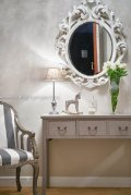 The elegant wall-mounted mirror sets the refined tone to come