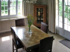 Dining area with extendable table; 2 more chairs out of shot