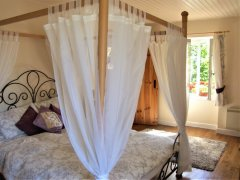 Romantic king size four poster