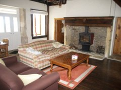 Large lounge with a wood burning stove