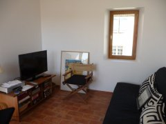 Living room / den, with window onto street