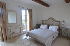 Bedroom with doors leading to balcony
