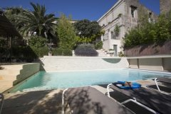 The pool and house