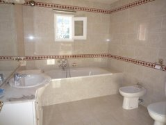 Large marble tiled bathroom