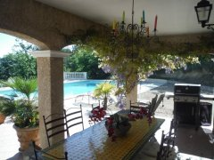 View from the outside dining area to the pool