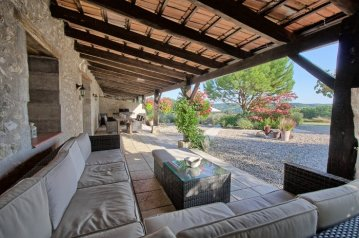 Large covered terrace with BBQ and comfortable lounge area