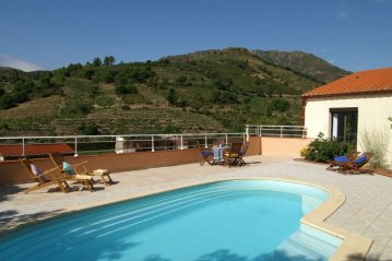 Pool with views to foothills of the Pyrenees.