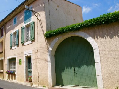 L'Ancienne Ecurie with double gates to private parking and small garden with terrace
