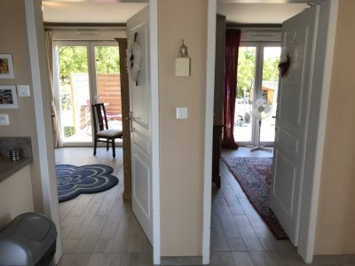 Doors to living and bedrooms from kitchen/diner