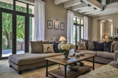Beautiful living room with high ceilings and french doors onto the terrace