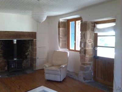 Lounge with woodburner and door to terrace