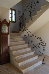 Beautiful staircase leading to two large bedrooms