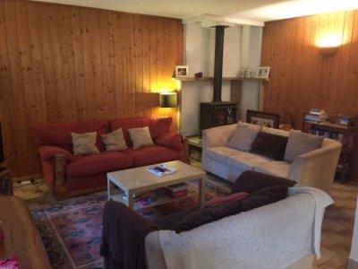 Large lounge area with woodburner