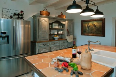 Kitchen with American style refrigerator