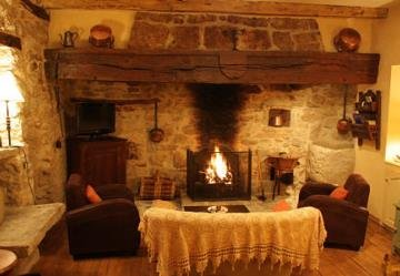 Cosy sitting room with log fireplace