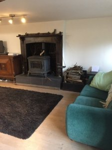 The lounge with wood burner.