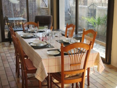 Dining for larger groups in sun room