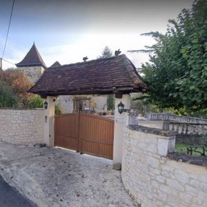 Front security gates to the property with large car park beyond