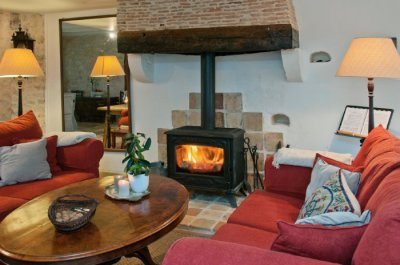 The woodburning stove creates a warm, cozy salon